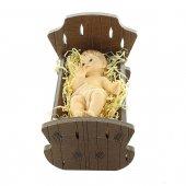 Immagine di 'Gesù Bambino in resina con culla in legno - dimensioni 8x12 cm'