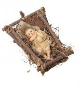 Gesù Bambino in resina su tronco in legno e letto di paglia - altezza 14 cm