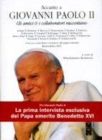 Accanto a Giovanni Paolo II