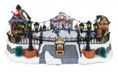 Villaggio natalizio con pista di pattinaggio, movimento, luci, musica (39 x 18,5 x 28 cm)
