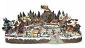 Villaggio natalizio con slitta pista di pattinaggio, movimento, luci, musica (64 x 28 x 45 cm)