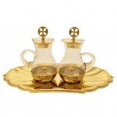 Servizio ampolline dorato con piatto ovale a forma di conchiglia