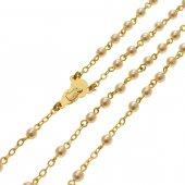 Immagine di 'Rosario dorato con grani di perla bianca e piccolo astuccio trasparente'