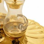 Immagine di 'Servizio ampolline dorato con piatto ovale a forma di conchiglia - capienza 90 cc'