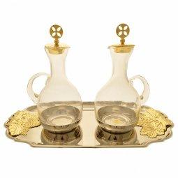 Copertina di 'Servizio ampolline su piatto argentato con decorazioni dorate a forma di grappoli d'uva - capienza 120 cc'