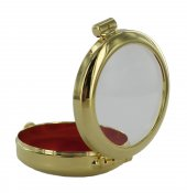 Immagine di 'Teca portareliquia tonda Ø 4 cm in ottone color oro'